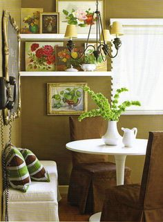 love the unusual way to display art in the kitchen nook