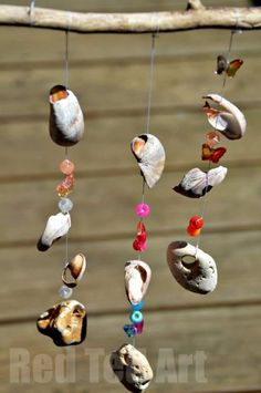 Seaside Windchime Craft from shells, stones and pony beads - We made these last year and they still look so pretty in our garden. After a recent visit to the seaside, we will be giving these another go!
