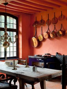 I wouldn't expect red would work so well for a backdrop for this magnificent collection of copper pots. Country Kitchen Designs, French Country Kitchens, French Kitchen, Country French, Copper Pots, Copper Kitchen, Kitchen Interior, Interior And Exterior, Home Design Decor