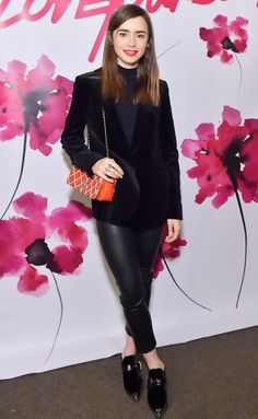 Lily Collins in a black blazer and leather pants