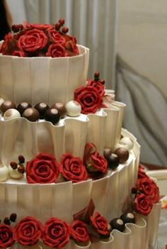 I know you are doing cupcakes but this is beautiful! Dark Chocolates & Red Roses wedding cake