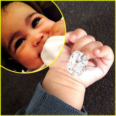 """Kim Kardashian reminisced about her """"amazing"""" 2013 by sharing a photo of her daughter North West holiday her engagement ring from Kanye West! Check out more pics on JustJared.com! Kim Kardashian Engagement Ring, Celebrity Engagement Rings, Engagement Rings Round, Kim And Kanye Baby, Kim Kardashian Kanye West, Just Jared, North West, Wedding Inspiration, Bling"""