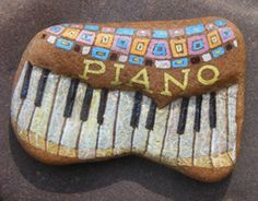 piano painted rock