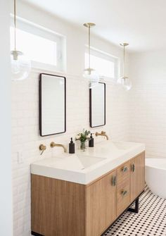 Subway walls, double mirrors with windows above, contemporary double vanity
