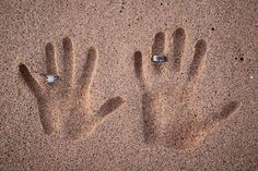 Handprints in the sand..