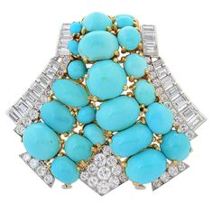 Cartier Art Deco Turquoise Diamond gold platinum Clip | See more rare vintage Brooches at https://www.1stdibs.com/jewelry/brooches/brooches