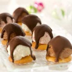 Homemade ice cream bonbons with vanilla wafers, ice cream, melted chocolate chips...easy peasey!