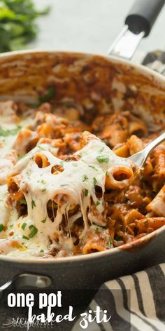 This One Pot Baked Ziti with Italian Sausage is full of flavor but easy on the dishes! It's made with turkey Italian sausage, spinach, tomato sauce and loaded with cheese -- the perfect weeknight dinner! Includes step by step recipe video.   easy recipe   easy dinner   healthy recipe   weeknight meal