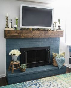 home decor painting Simple fall mantel decor. This blue brick fireplace and diy rustic mantel are the perfect backdrop for easy thrifted fall decor. Painted Brick Fireplaces, Paint Fireplace, Brick Fireplace Makeover, Home Fireplace, Fireplace Ideas, Brick Fireplace Remodel, Black Brick Fireplace, Simple Fireplace, Farmhouse Fireplace