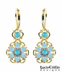 Lucia Costin Fancy Dangle Earrings Set with Twisted Lines and .925 Sterling Silver Flower Accents , Crafted with Light Blue and Turquoise Swarovski Crystals; .925 Sterling Silver Plated with 14K Yellow Gold; Handmade in USA Lucia Costin. $56.00. A perfect feminine touch. Lucia Costin floral Dangle earrings. Enhanced with aquamarine and turquoise Swarovski crystals. Update your everyday style with inspiration when wearing this piece of jewelry. Unique jewelry handmade in USA