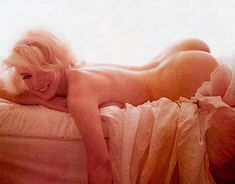 On this day in 1962, Bert Stern captured this lovely image of Marilyn Monroe naked in her bed. It would be one of the last images taken of Marilyn.