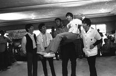 Muhammad Ali then Cassius Clay lifts Ringo Starr into the air while The Beatles visited Clay's camp in Miami Beach Fla.  February 18 1964.