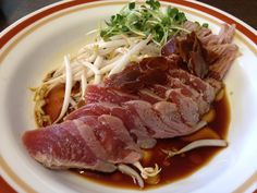 Ethel's Famous Tataki Sashimi from Ethel's Grill in Kalihi. A side dish of fresh tuna lightly seared, served on a bed of bean sprouts and drizzled with sesame oil and Ethel's Garlic-Shoyu Sauce.