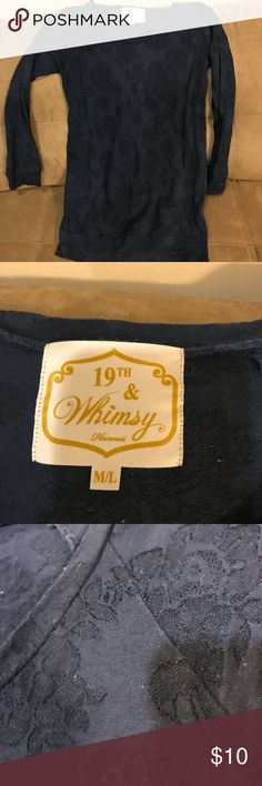 Shirt Noticed that tag states it is a.m./L size.Comes from a Smoke free home. Offer 20% discount when bundling items. 19th & Whimsy Tops