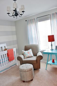 Project Nursery - Gray Striped Orange and Aqua Nursery. Love the ABC pillow fabric and the different fabric on ottoman