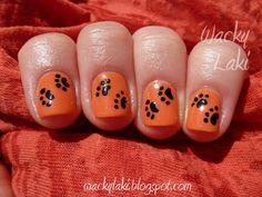 Nail Art ~ Black small paw prints over orange base.