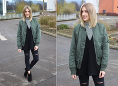 Green Bomber Jacket, ripped denim jeans and ankle boots on uk fashion blog