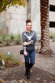 Deer sweater, plaid, jeans & boots with red accents