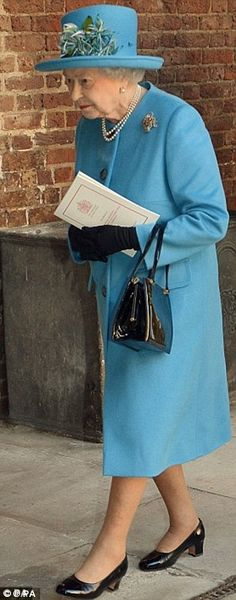 Arm candy: The Queen also totes her favourite Launer handbag and the brand say she takes a selection with her on trips.