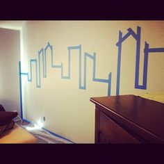 Painting Gotham City accent wall. Superhero room.