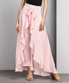 Flaunt your chic style in these gorgeous pants with ruffle accents and a breezy design that billows in the wind.Made for zulilyModel: 5' 8'' tall; 33'' chest; 24'' waist; 35'' hipsSize S: 33'' inseamKnit96% rayon / 4% spandexMachine wash; hang dryImported