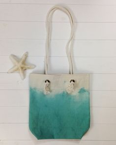 À La Plage {at the beach} is a collection of beach-inspired canvas bags and accessories. Hand-dyed tote made from a durable cotton canvas and nautical rope.