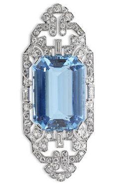 An Art Deco aquamarine and diamond brooch, by Liberty, circa 1930. Of elongated…