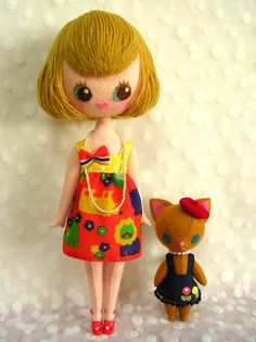 Girl and cat by Japanese doll artist Aketsun.