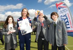 Students from Knole Academy present Lizzy with a picture drawn by one of the students