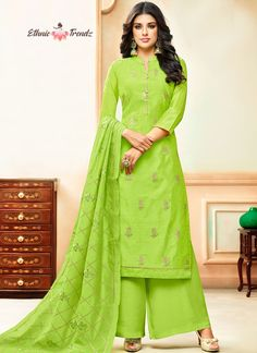 Make the heads turn whenever you costume up with this stunning green art silk designer palazzo suit. The embroidered work appears chic and perfect for any event. Comes with matching bottom and dupatta. Salwar Suits Online, Designer Salwar Suits, Bollywood Dress, Bollywood Fashion, Palazzo Suit, Salwar Designs, Indian Salwar Kameez, Green Art, Indian Ethnic Wear