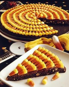 Candy Corn Brownie Pizza from Love from the Oven....a collection of LOTS of different things to do with candy corn!  Can't wait 'til this fall!