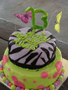 Alexis's 13th birthday cake--- Top tier Chocolate with cream cheese filling, bottom tier Vanilla with pineapple filling