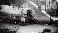 Soviet soldiers investigating destroyed V2 Maus prototype, Kummersdorf proving grounds, May 1945