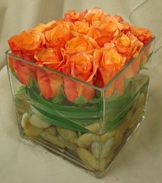 This is an arrangement of orange roses.  See our entire selection at www.starflor.com.  To purchase any of our floral selections, as gifts or décor, please call us at 800.520.8999 or visit our e-commerce portal at www.Starbrightnyc.com. This composition of flowers is generally available for same day delivery in New York City (NYC). RO057