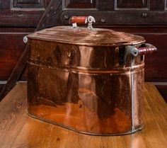 Antique copper boiler pot. With its sturdy wooden handles, this Revere kitchen staple was built to last.