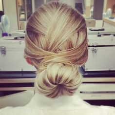 Add a little pizazz to your bun by opting for this criss-cross style. Best for blondes, as darker hair might not show the detail.