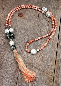 Beautiful mala necklace made from 108, 6 mm - 0.236 inch, jasper gemstones and decorated with opal, jade and pyrite.  The total length of the mala is approximately 81 cm - 31.89 inch.