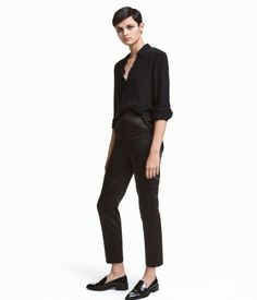 Black. Dressy pants in thick satin with a regular waist, concealed zip at back, and tapered legs.