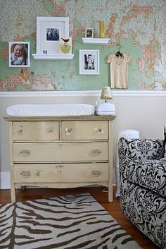 Place a large wall map on top 1/2 of wall in office; place crown molding near center for separation