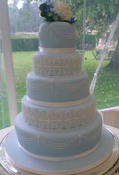 blue and white wedding cake with lace