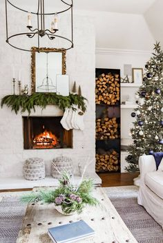 Living Room - Christmas Home Tour 2020 - Farmhouse Living - Christmas Decor - Modern Farmhouse - Metal Fire Wood Holder - German Smear Fireplace - Layered Rugs - Sherwin Williams Alabaster White - Currey and Company Fitzjames Black Large Lantern - Christmas Fireplace - Fireplace Mantle Decor - Evergreen Garland
