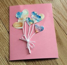 Cut hearts from your kid's art for DIY Valentine's Day heart balloon card.