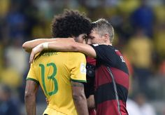 Germany's Bastian Schweinsteiger, right, consoles Brazil's Dante after the World Cup semifinal soccer match between Brazil and Germany at the Mineirao Stadium in Belo Horizonte, Brazil, Tuesday, July 8, 2014. Germany won the match 7-1. (AP Photo/Martin Meissner)