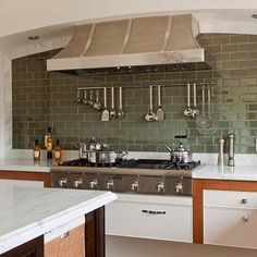 Love this color with our wood trim and white cabinets  30 Successful Examples Of How To Add Subway Tiles In Your Kitchen