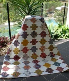 This quilt made by Kay Haydon is English paper pieced and hand quilted. It is made with the wonderful Dutch Chintz fabrics. Japanese Puzzle block.