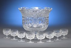 A wonderful American Brilliant Period cut glass punch bowl decorated with a row of daisies and a cane border. Includes a set of eight matching cups. 11 high x 12 diameter Cup s: 3 high x 2 diameter Cut Glass, Glass Art, Liquor Glasses, Punch Bowl Set, Crystals For Sale, Antique Glassware, Broken China, Glass Chandelier, Crystal Collection