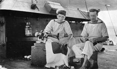 Two signalmen of HMAS Melbourne mend their clothing at sea. Signalman Ernesto Campagnolo, born in Walhalla, Vic, (left, using a Singer sewing machine) was lost at sea on 21 December 1916 during some rough weather, North Sea, Atlantic Ocean. Image from Australian War Memorial collection. 1916