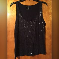 New York & Co Navy Sequin Tank New York and Company Navy Sequin Tank Tank Tops. The navy tank has sequins all over the front.  size Large - 100% Rayon Can be used to dress up and shimmer any outfit! New York & Company Tops Tank Tops