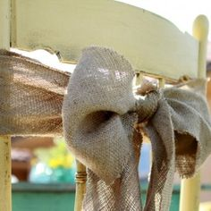 Burlap Bow...love this for chair decor!