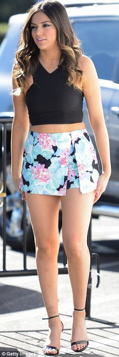 Flower power: Bethany looked fashionable in a floral patterned mini skort with a black halter top and strappy black leather heels